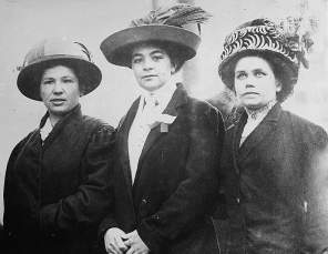 Early 20th century photo of three women in Lowell wearing elegant hats.